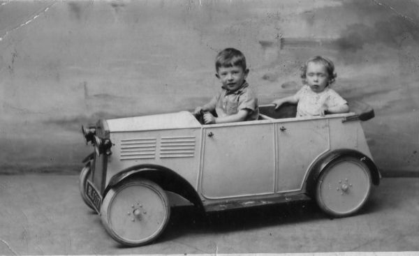 Studio Portrait Two Young Brothers In Model Car 1936