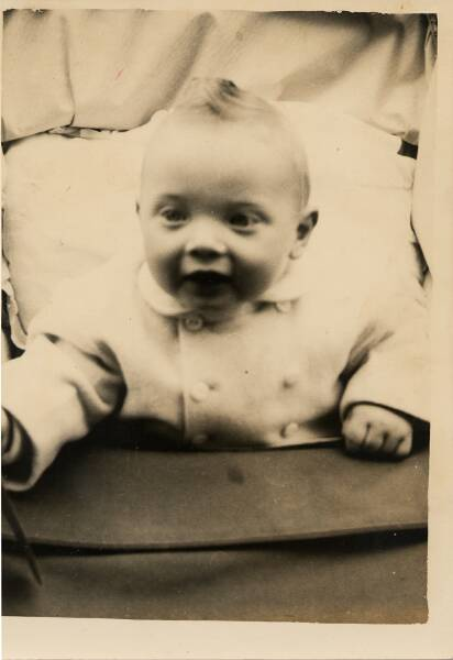 Young Boy Sitting Up In Pram 1959