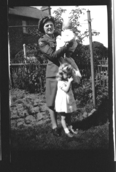 ATS Member With Her Niece And Nephew In Garden Of Their Home At 39 Northfield Crescent, early 1945