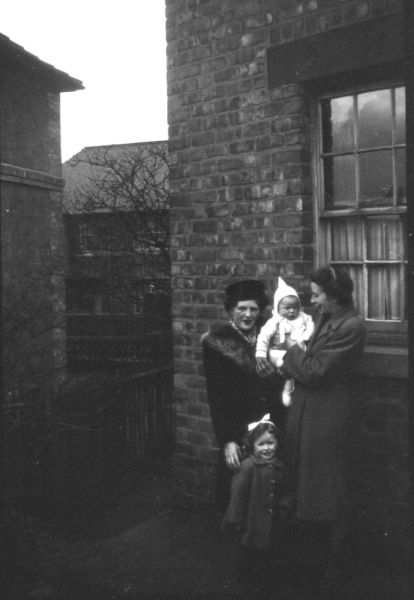 Family Portrait Outside House In Winter 1945