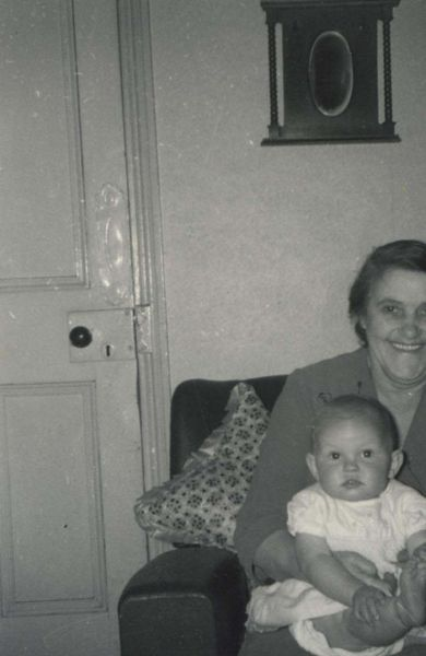 Grandmother Sitting With Granddaughter In Sitting Room c.1961