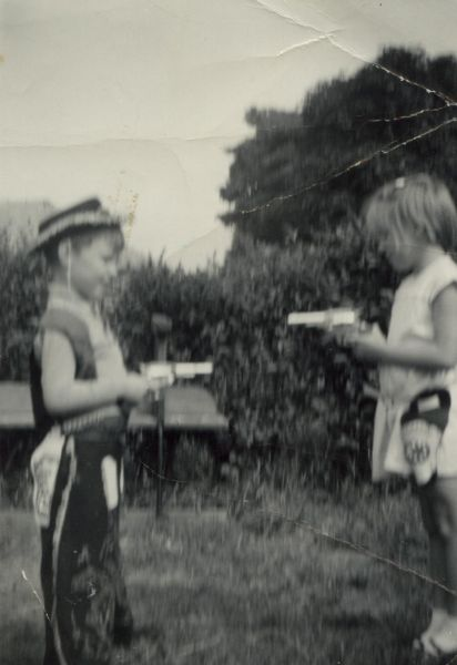 Brother And Sister Playing Cowboys In Back Garden c.1967