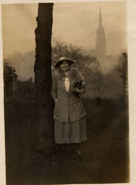 Woman Standing By Tree Trunk In Graveyard 1920s