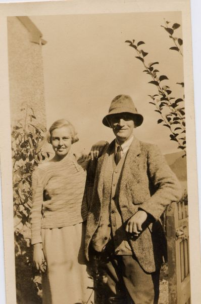 Man And Woman Standing By Gate 1920s