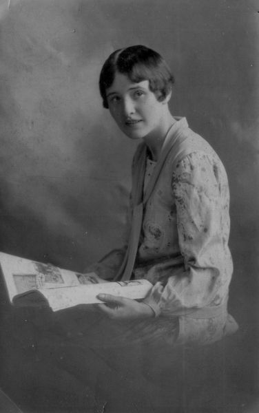 Studio Portrait Young Woman Sitting With Scrapbook  c.1928