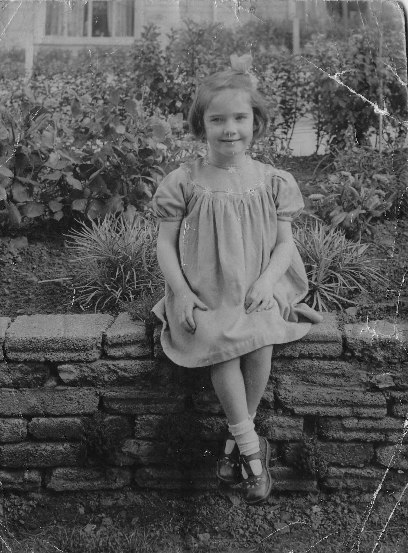 Young Girl Sitting On Garden Wall 1952