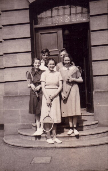 Tennis Players Standing On Steps By Doorway, June 1938