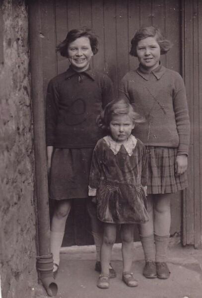 Three Girls Standing By Doorway And Drainpipe 1931