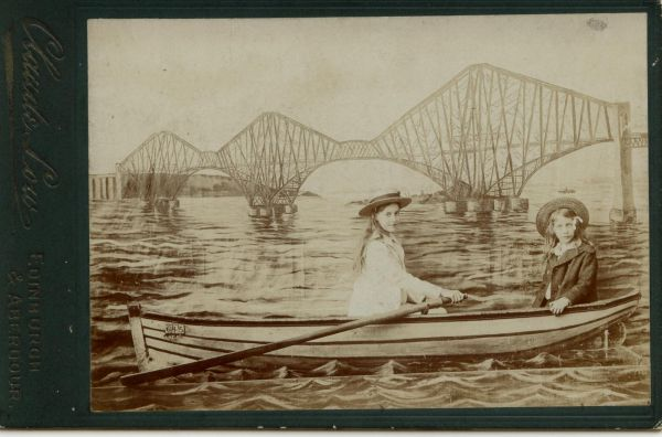 Studio Portrait Two Girls In Rowing Boat With Forth Bridge Backdrop 1890s