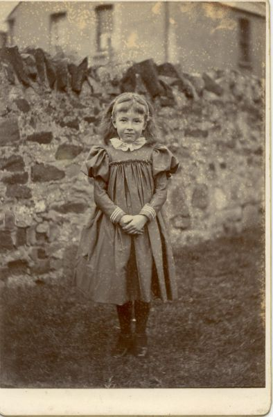 Girl Standing In Garden Dressed In Sunday Clothes c.1900