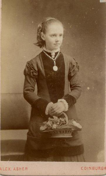 Studio Portrait Girl With Basket Of Flowers c.1880