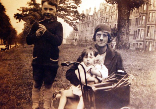 Brother And Sister With Family Friend On The Meadows 1931