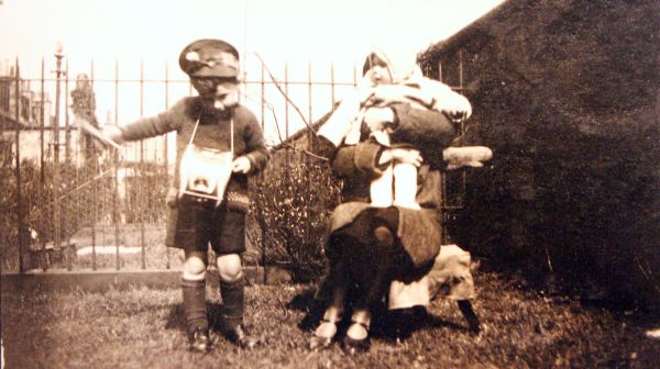 Young Boy Playing At Ticket Conductor In Back Garden 1930