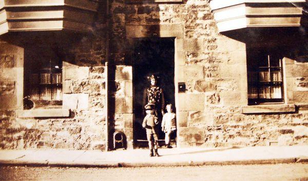 Woman And Children Standing In Elie Doorway 1929