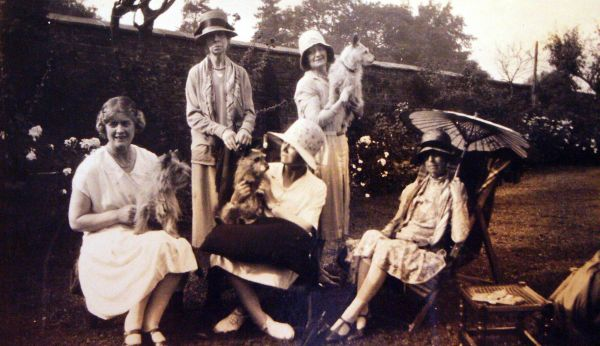 Women With Their Dogs In The Garden 1920s