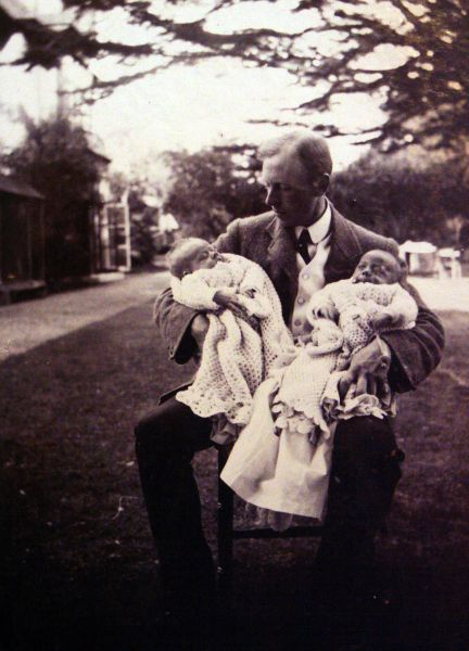 Father Sitting In Garden Holding His Twin Sons c.1911