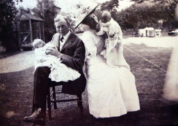 Edwardian Parents Sitting In Garden With Their Twin Sons c.1911