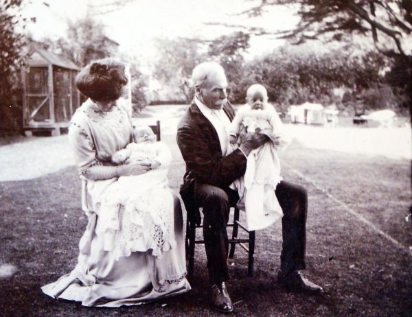 Grandparents Sitting In Garden With Their Twin Grandsons  c.1911