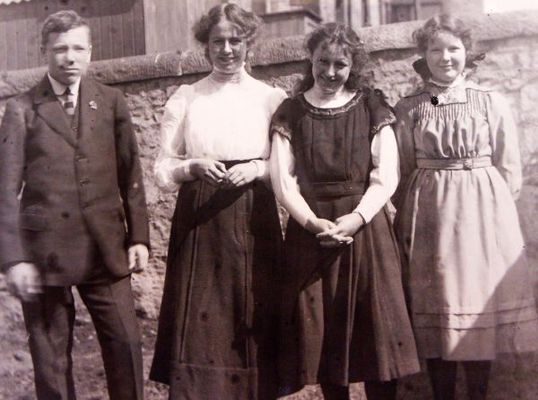 Family With Friend Standing In Garden c.1912