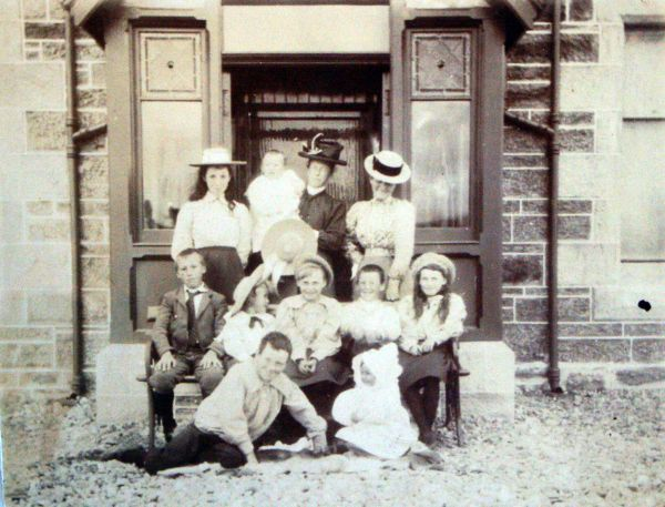 Large Family Group Sitting On Doorstep Of Porch c.1898