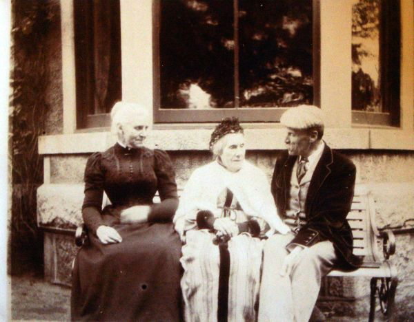 Elderly Mother Sitting On Bench With Her Daughter And Son c.1895