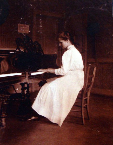 Young Woman Playing The Piano c.1900