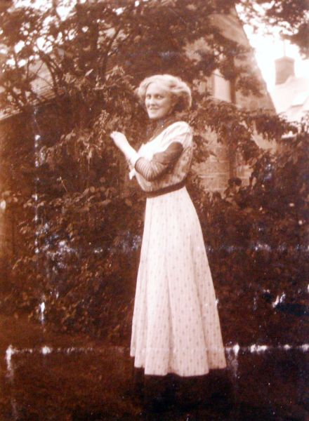 Young Woman Standing In The Garden, May 1910