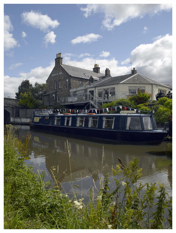 Canal boat and the Bridge Inn at Ratho