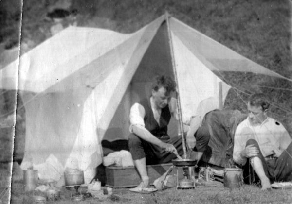 Two Young Men By Tent Cooking Camp Meal c.1912