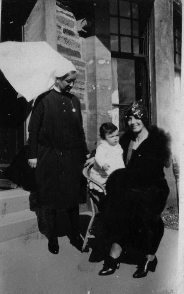 Matron Standing At Doorway Of Hospital With Woman And Child c.1931