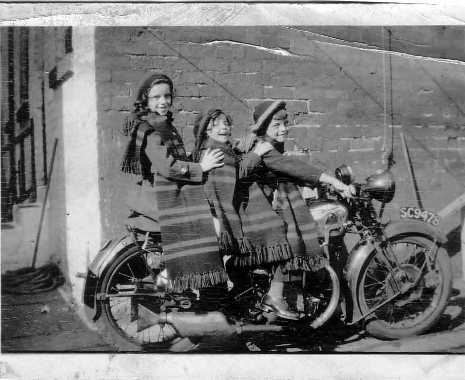 Three Children Sitting On Motorbike c.1934