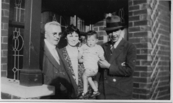 Young Family Standing In The Porch Of House In Shettleston 1928