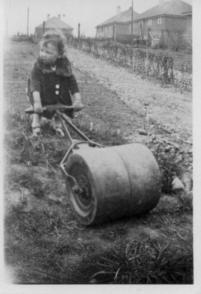 Young Girl Pushing Garden Roller 1932