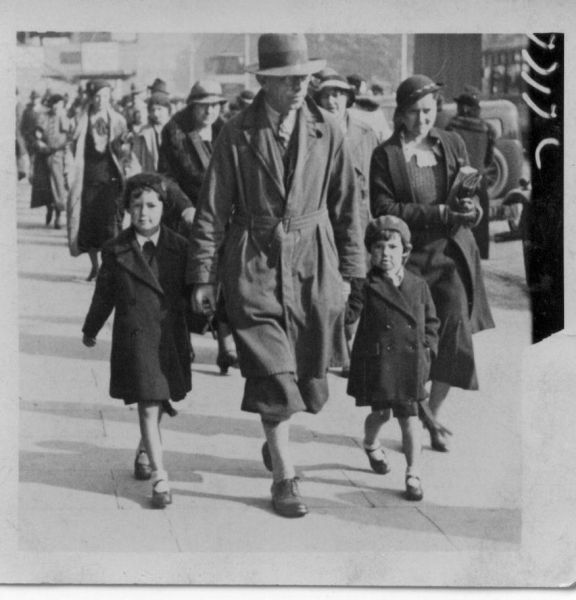 Father With Daughters Walking along Street c.1934