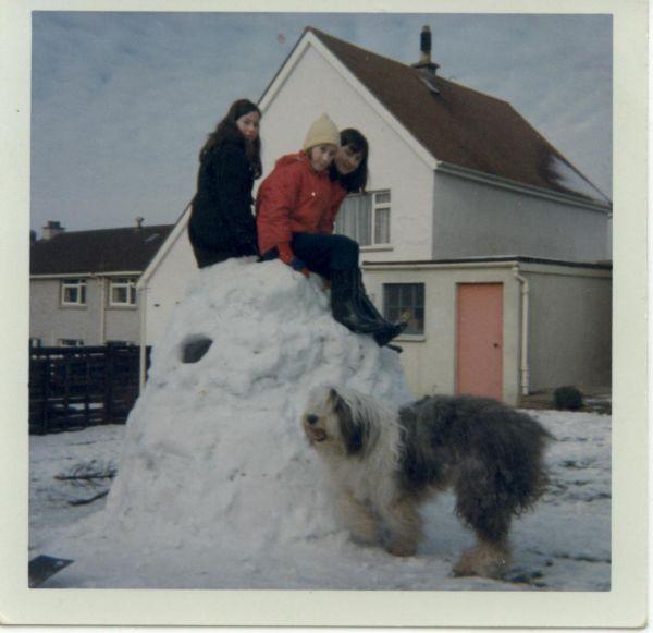 Three Girls Sitting On Top Of Mound Of Snow In Garden At 32 Bramdean Rise c.1966