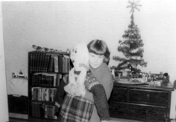 Young Girl Hugging Her Christmas Present From Santa 1965