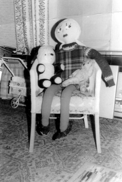Life-Sized Christmas Present Doll Sitting In Chair 1965
