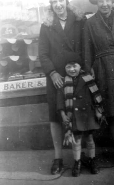 Family Standing Outside The Bakers At Port Bannatyne c.1931