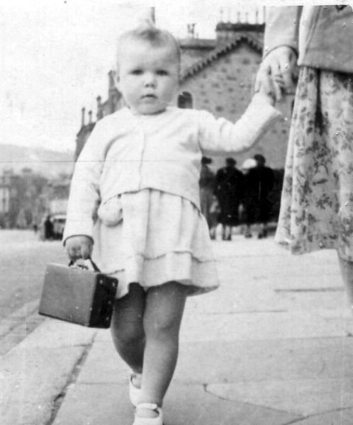 Young Girl Carrying Small Case, September 1951