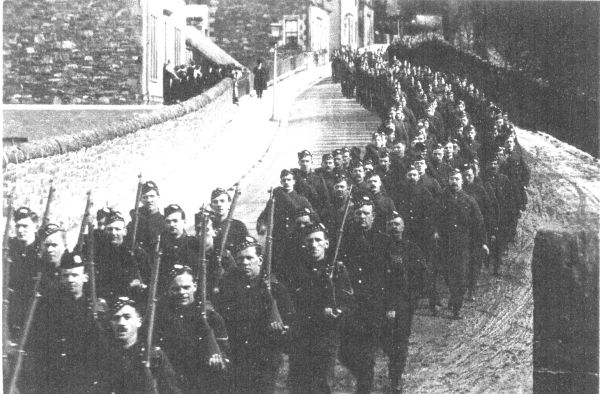 Soldiers Marching Through Unidentified Street c.1916