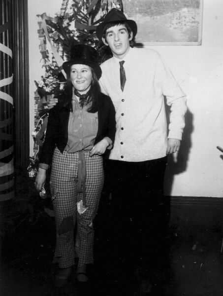 Couple Standing By Christmas Tree, late 1960s