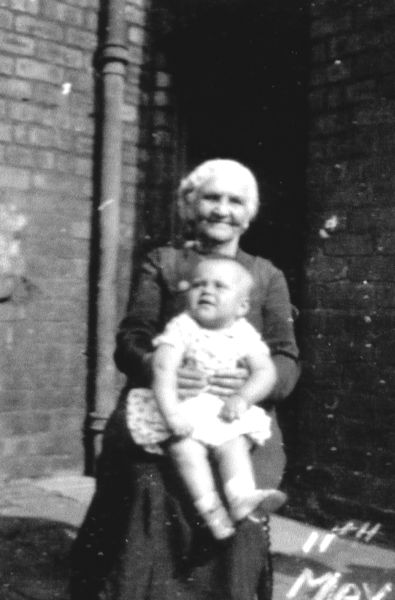 Elderly Woman Sitting With Child At Dean Park, 11 May 1940