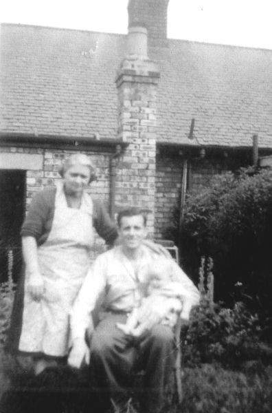 Husband And Wife With Eldest Son In Back Garden c.1950