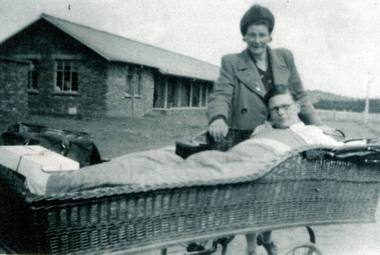 Mother Standing With Son Lying In Wicker Stretcher At Bangour Hospital, July 1947
