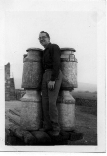 Young Man Standing Between Milk Urns 1964