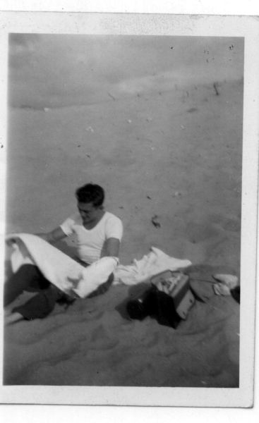 Young Man Grappling With Towel On Beach c.1950