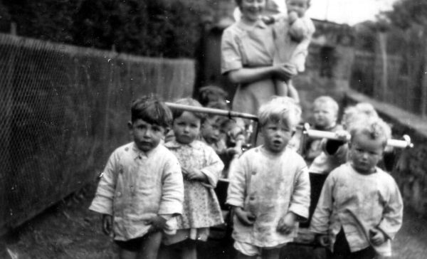 Nurse And Toddlers Taking Walk At Stenhouse Day Nursery 1955