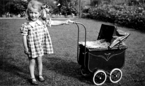 Young Girl Playing With Pram In Back Garden At Kingsknowe Crescent, September 1940