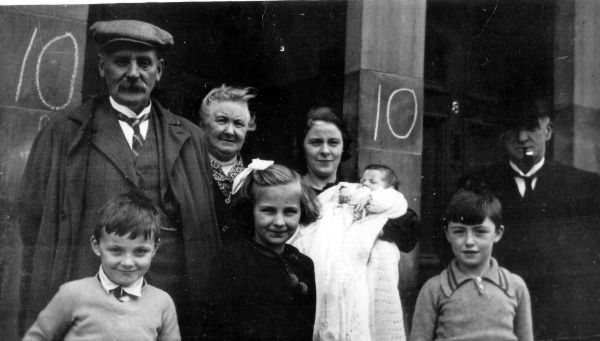 Family Standing In Doorway Of 10 Moat Terrace On Day Of Child's Christening, November 1938