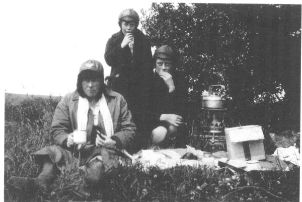 Mother And Daughters Having Picnic In A Field c.1925